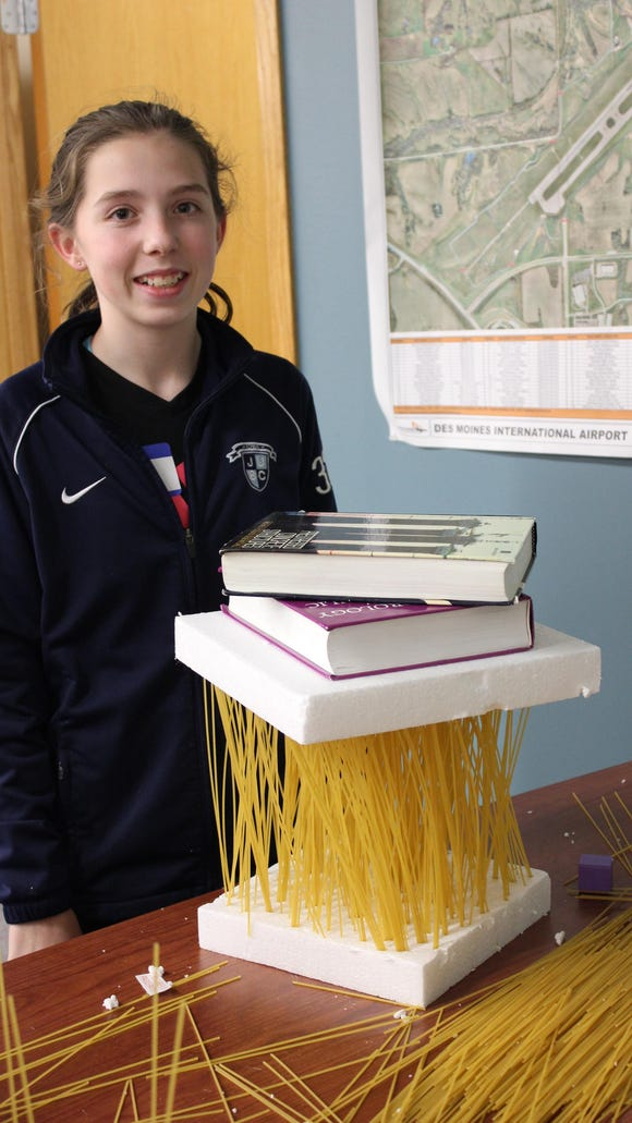 Emma Johansen shows how strong spaghetti can be when