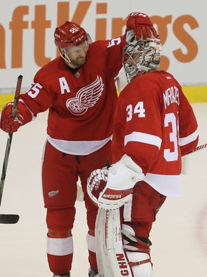 Red Wings defenseman Niklas Kronwall and goalie Petr Mrazek celebrate the 2-1 shoot-out win over the Blue Jackets Tuesday at Joe Louis Arena.
