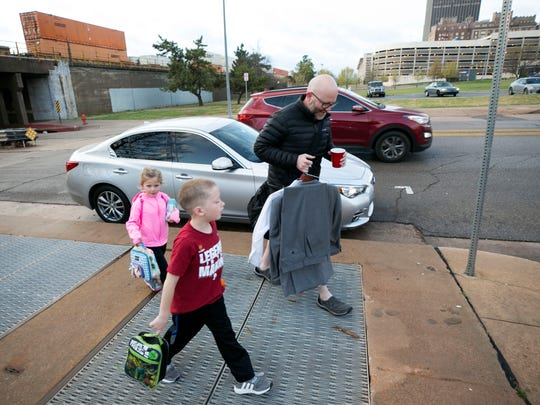Matthew Smith of Oklahoma City, drops off his children