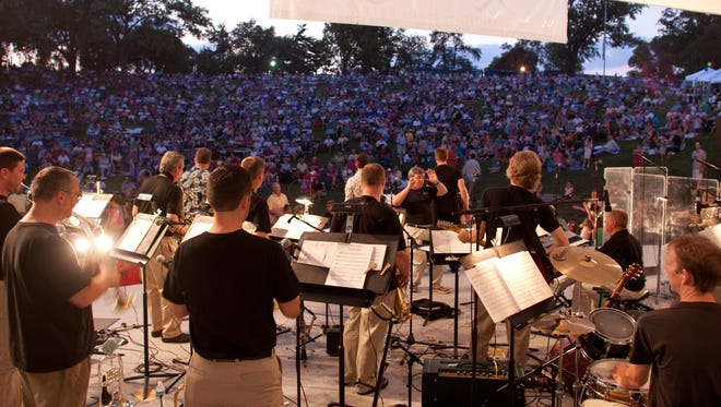 The Kentucky Symphony Orchestra's Boogie Band performs in Covington's Devou Park. Toyota has sponsored the KSO's summer concert series for several years.