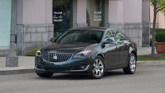 The 2014 Buick Regal is shown in Ashen Gray equipped with 18-inch? wheels and sunroof.