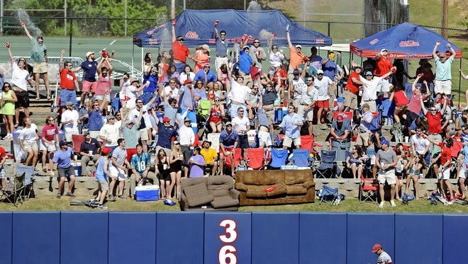 Students celebrate a home run by Mississippi's Sikes Orvis during the fifth inning of an NCAA college baseball game against Arkansas in Oxford, Miss., Saturday, May 3, 2014. (AP Photo/The Daily Mississippian, Thomas Graning)