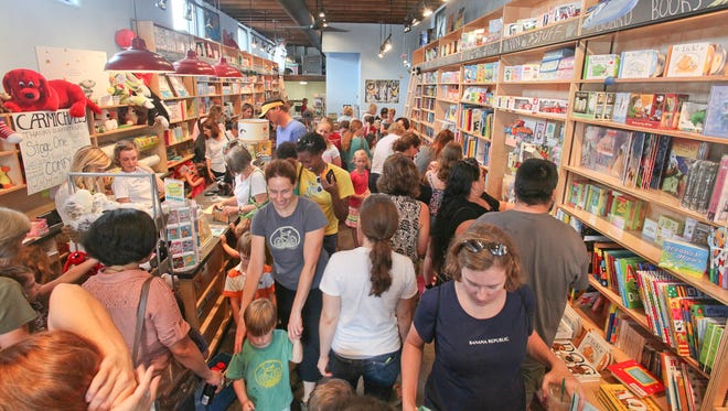 Scene during the grand opening of Carmichael's Kids on Bardstown Road in Louisville, KY. Aug. 10, 2014