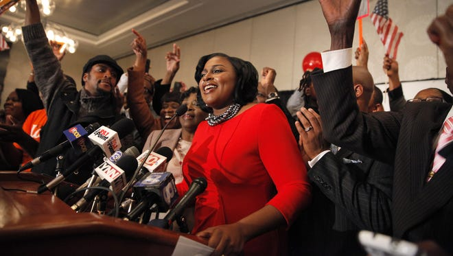 Lovely Warren, center, speaks to the crowd after her victory in the Rochester mayoral race on Tuesday, Nov. 5, 2013.