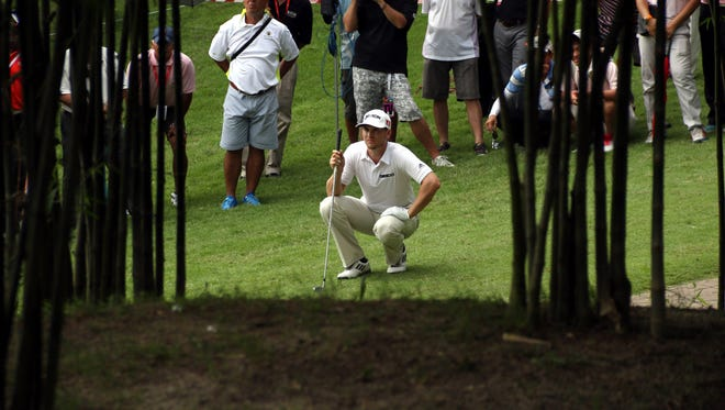 Chris Stroud of the USA prepares to play his third shot on the 18th rough hole during the third round of the CIMB Classic at Kuala Lumpur Golf & Country Club.