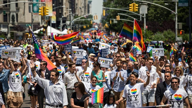 Revelers march down Fifth Avenue in the New York Gay Pride Parade on June 30, 2013.