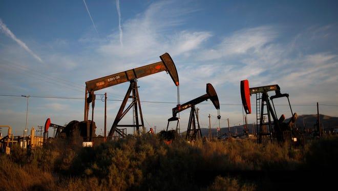 Pump jacks and wells in an oil field near McKittrick, Calif.