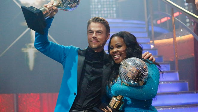 "Champions Amber Riley and Derek Hough from Season 17 of ""Dancing With The Stars."""