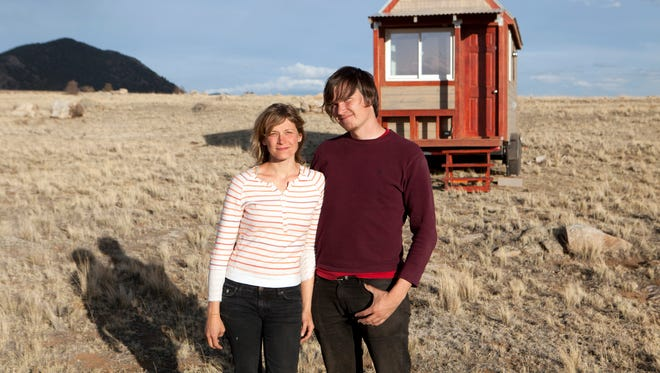 Merete Mueller and Christopher Smith pose in front of their tiny house, featured in the documentary 'Tiny.'
