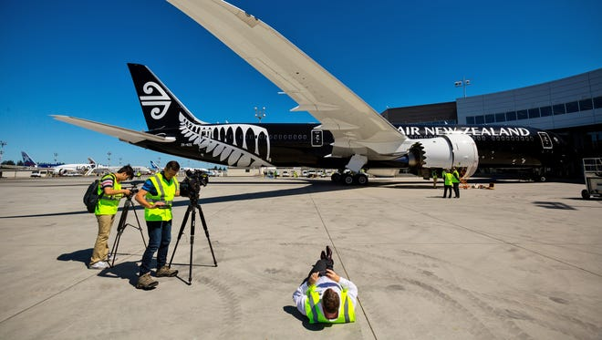 Media take photos and video of Air New Zealand's first Boeing 787-9 Dreamliner on July 9, 2014, at the Boeing's Delivery Center in Everett, Wash.