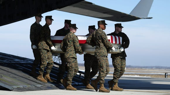 DOVER, DE - FEBRUARY 18:  A U.S. Marine Corps carry team moves the flag-draped transfer case holding the remains of Master Sgt. Aaron Torian of Paducah, Ky., during a dignified transfer at Dover Air Force Base Feb. 18, 2014 in Dover. CHIP SOMODEVILLA/VIA GETTY IMAGES