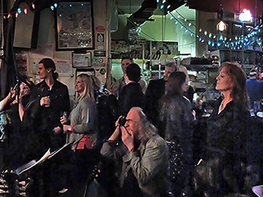 Jamie Rubin and the Sons of Zevon play to a packed crowd on Feb. 21, the last night of the old Family Wash.