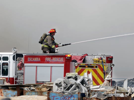 Firefighters battle a blaze at GSI Recycling on Hollywood Ave. Saturday morning. Deputies blocked off Hollywood Ave. at Avery St. during the blaze. There were no injuries.
