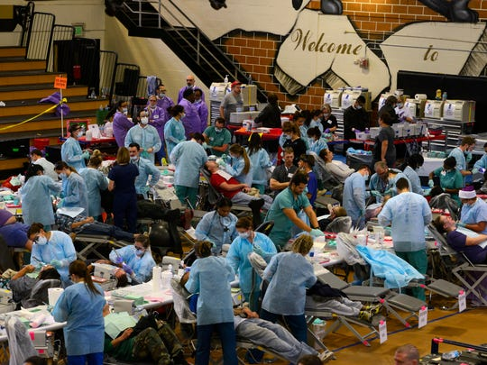 Dentists work on patients Saturday at the Remote Area Medical clinic at Milton High School. Patients received free medical, dental and vision services as well as free hair cuts.