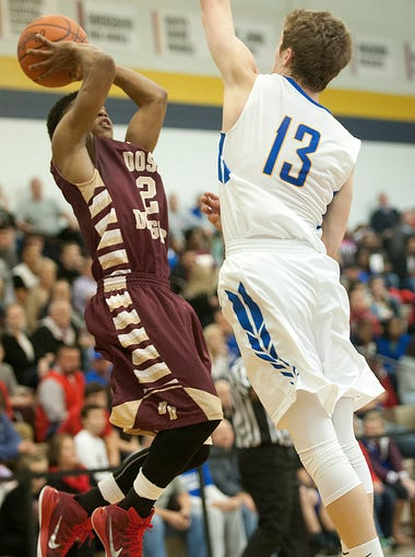 Doss Dragons guard Dujuanta Weaver aims for the basket
