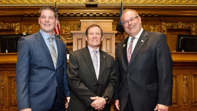 Representative Tyler Vorpagel (R-Plymouth) (left) and Representative Terry Katsma (R-Oostburg) (right), on behalf of the Wisconsin State Assembly, have honored Roy Pirrung (center) of Plymouth as a Hometown Hero.