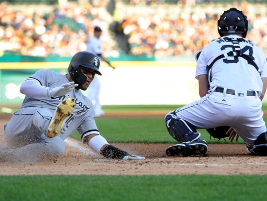Chicago White Sox's Yoan Moncada (10) is safe at home as Detroit Tigers catcher James McCann (34) fields the throw in the second inning of a baseball game, Saturday, Sept. 16, 2017, in Detroit. (AP Photo/Jose Juarez)
