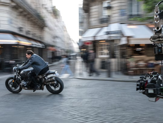 "Tom Cruise flies through the streets of Paris in ""Mission:"