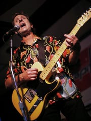 Lindy Fralin, whose early interest in guitar pickups came from his dissatisfaction with a 1970's Fender electric guitar of his own, plays with his band, the Bopcats, in Richmond.