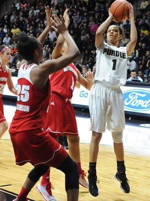 Junior Ashley Morrissette was red hot, here getting a jumper from outside the lane Sunday.