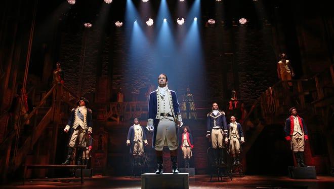 "Lin-Manuel Miranda, center, stars as Alexander Hamilton in the Broadway musical ""Hamilton."""