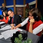 Employees of The Greenville News and The Asheville Citizen Times answer phones and take donations during a WYFF4 Holiday Sunshine Fund live broadcast on Wednesday, December 10, 2014.