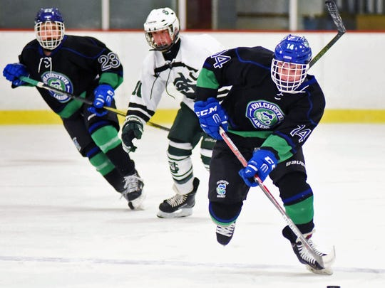 Colchester's Luke Dion pushes forward during the Lakers'