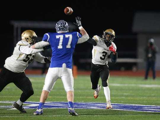 Athena quarterback Tavon Granison throws over Whiteboro's Zach Wessinger (77) during the Class A state semifinals.