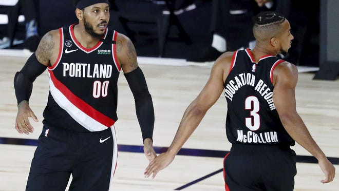 Carmelo Anthony (00), CJ McCollum and the the Portand Trail Blazers are in the best position of the four teams vying for two Western Conference play-in berths entering Thursday's games.