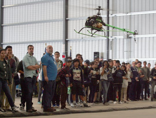 A remote-controlled helicopter takes flight during