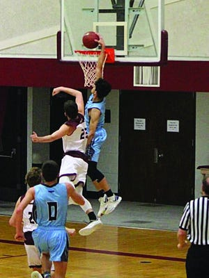 Eliazar Carrasco rises above the field for a Skyline dunk and score. The Skyline Thunderbirds of Pratt defeated two teams last week by completely lopsided scores.