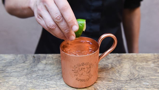 Smirnoff vodka teaches invited guests how to create an original Moscow Mule during Tales of the Cocktail at Little Gem Saloon on July 21, 2016 in New Orleans, Louisiana.