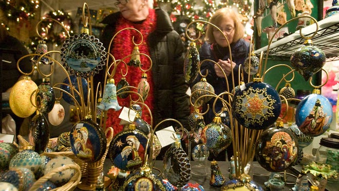 Patrons browse the displays Friday Dec. 2, 2011, of the Old World Christmas Market at The Osthoff in Elkhart Lake.