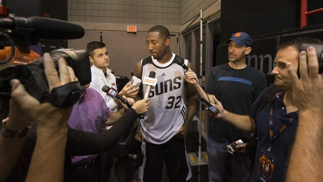 Davon Reed answers questions at the Suns practice Court in Talking Stick Resort Arena in Phoenix, Ariz. on July 6, 2017.