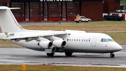 FILE - This is a Nov. 11, 2012 file photo taken at Birmingham Airport in central England of a BAE 146 aircraft  similar to the one which has crashed in Colombia  Tuesday Nov. 29, 2016. Colombian officials say that a chartered plane carrying a Brazilian first division soccer team has crashed near Medellin while on its way to the finals of a regional tournament. The British Aerospace 146 short-haul plane,  was operated by a charter airline named LaMia.