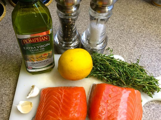 Slow roasting with lemon, garlic and thyme prevents salmon from drying out.
