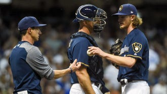Josh Hader hands the ball to manager Craig Counsell in the eighth inning after he was unable to protect the Brewers' one-run lead against the Cubs on Monday night. ;