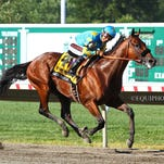 American Pharoah, with Victor Espinoza aboard, wins the $1,750,000 William Hill Haskell Invitational on Sunday at Monmouth Park.