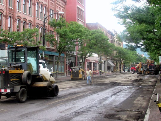 Crews work on a resurfacing project along Market Street