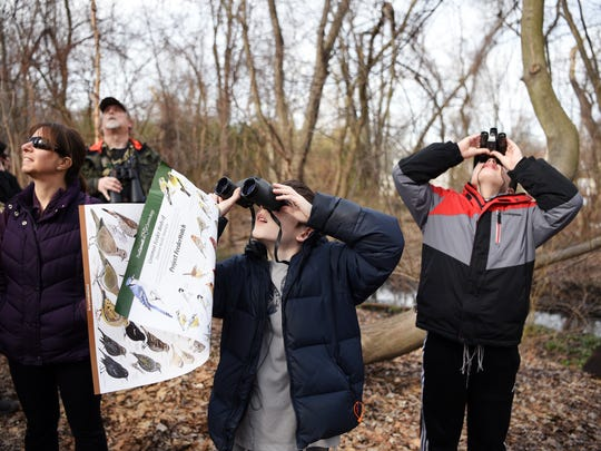 "Daniel Brauner, 13, left, and Samson Bierig, 11, participate in the 20th annual Great Backyard Bird Count, a worldwide event, hosted locally by the the Bergen County Audubon Society. During the four-day event, bird enthusiasts become ""citizen scientists"" and count the number of birds they see."