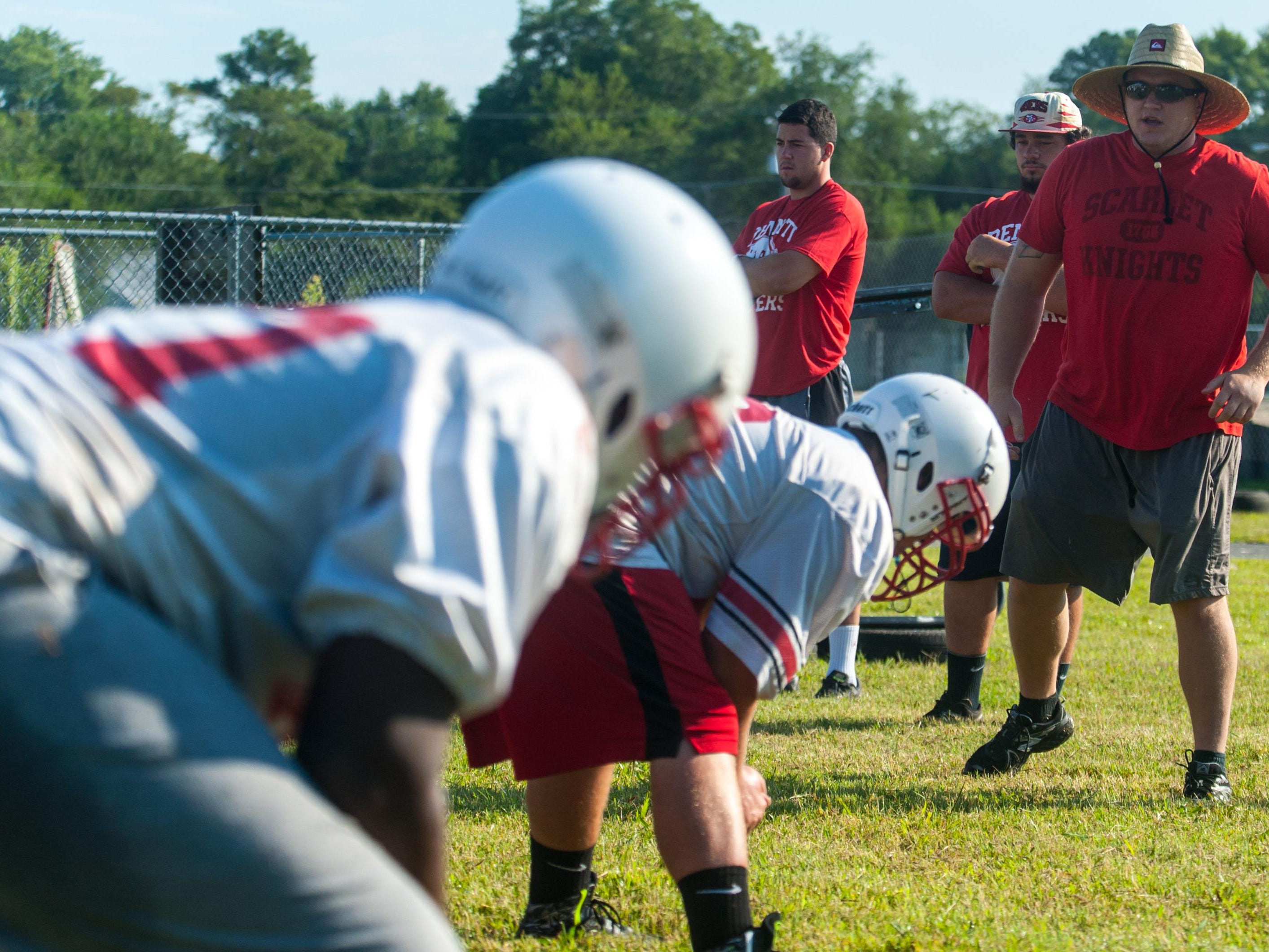 The James M Bennett offensive line recieves instruction on the second day of practice.
