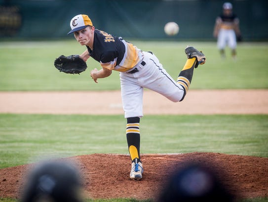 Cowan's pitcher launches a pitch toward home plate