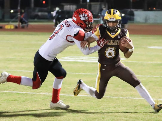 Golden West's Kai Caudell (8) rushes past Big Bear's