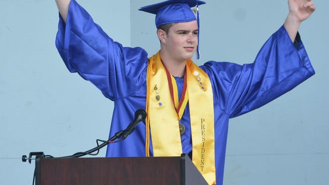 Somersworth High School Class of 2020 President Dylan Zinkevich throws his arms in the air after turning the tassle during the school's graduation ceremony on Friday.