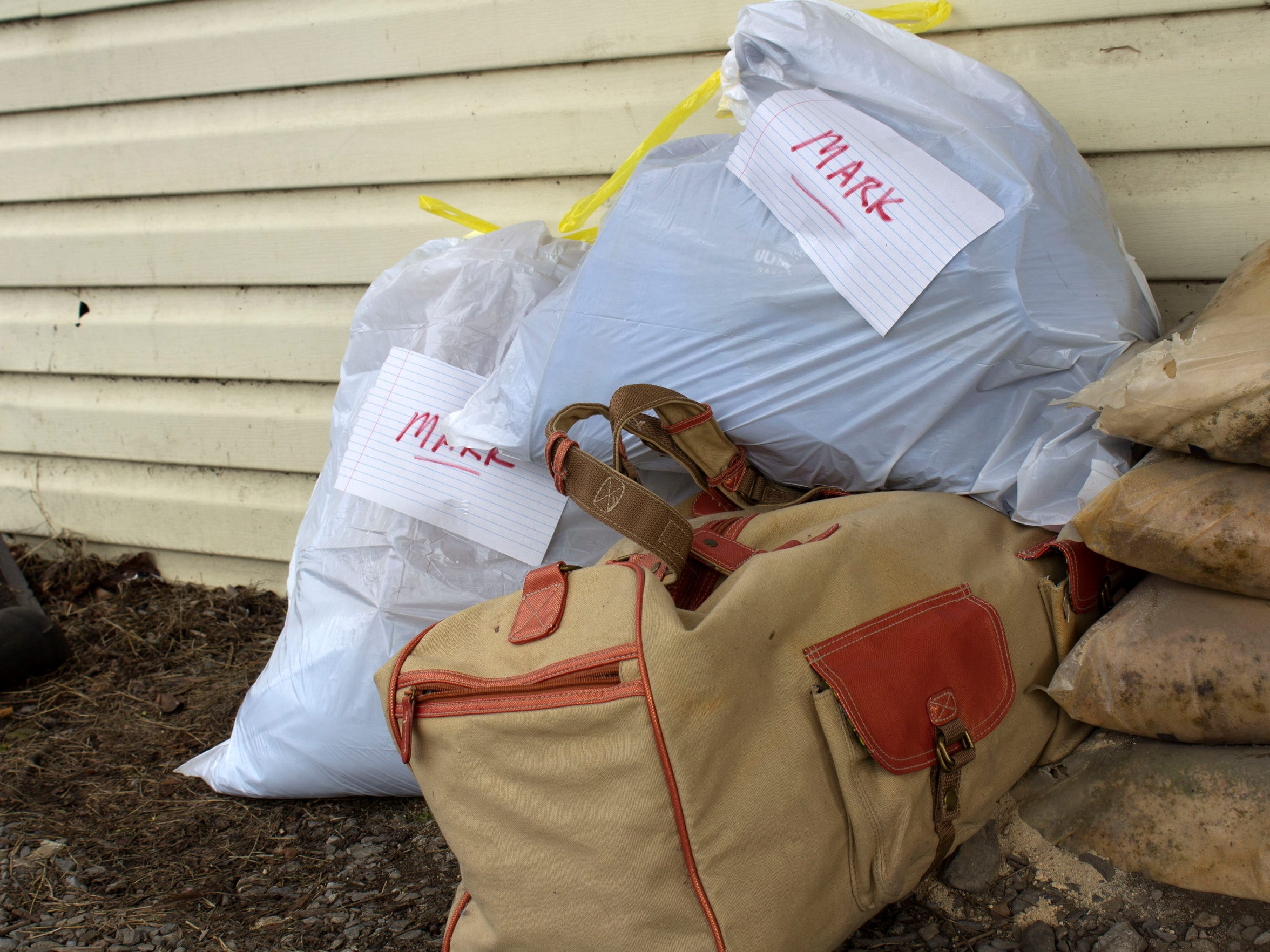 Several bags containing items belonging to a resident