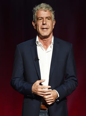 """Bourdain speaks on stage during the Turner Upfront presentation in 2016 in support of """"Parts Unknown."""""""