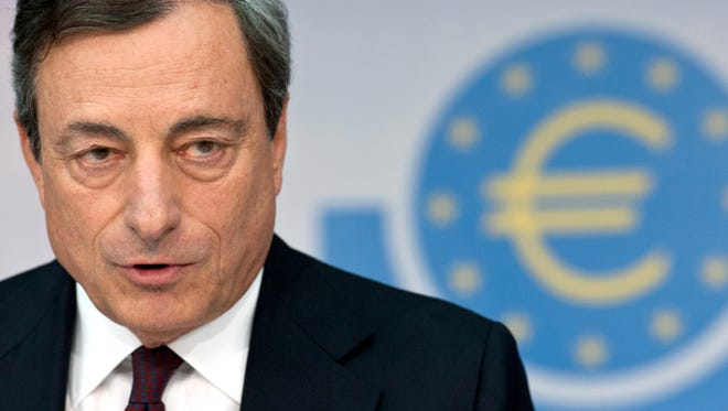 In this Aug. 7, 2014. file photo Head of the European Central Bank, ECB, Mario Draghi attends a news conference in Frankfurt, Germany.