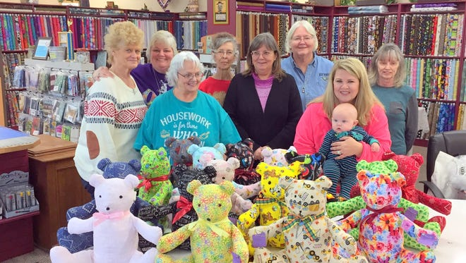 Eight quilters worked a day and a half to create 20 Teddy Bears at A Quilting Stitchuation to be given to children in need who live in Timberon.