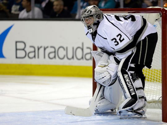 Los Angeles Kings goalie Jonathan Quick rests during a stoppage of play during the second period of Game 2 of an NHL hockey first-round playoff series against the San Jose Sharks Sunday, April 20, 2014, in San Jose, Calif. (AP Photo/Ben Margot)