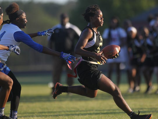 Florida High's Janae Scott tries to outrun Godby's